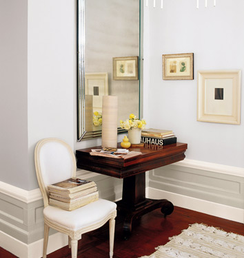 White Walls with White Chair and Mahogany Pedestal Table