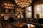 Library with Brown Leather Chesterfield and Circular Chandelier